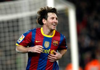 Barcelona's Messi celebrates a goal against Real Sociedad during their Spanish First Division Soccer League match at Nou Camp Stadium in Barcelona